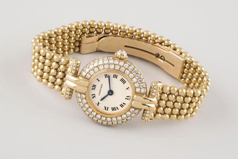 106 Reloj CARTIER, modelo Colisee de oro para señora. Movimiento de cuarzo con funciones horarias y minuteras. 01