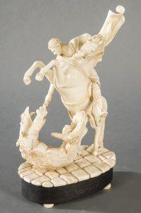 528 Escuela Española S. XX San Jorge y el Dragón Grupo tallado en marfil con peana de madera ebonizada.00
