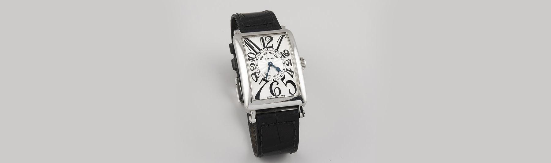 123-Reloj-FRANCK-MULLER-modelo-Long-Island,-realizado-en-acero.-Movimiento-de-cuarzo-con-funciones-horarias-y-minuteras.-Caja-cuadrada,-esfera-metálica-en-guilloche,-numeración-arábig.01