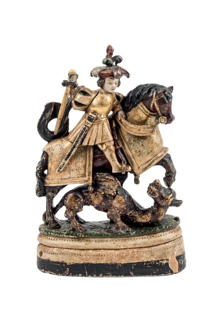 857 San Jorge matando al dragón. Talla de bulto redondo dorada y policromada. Oreja del dragón rota y pegada. Escuela colonial S. XVII